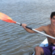 Foto Stock: Young mon kayak