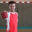 Handball player in front of goal — Stock Photo