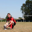 Stock Photo: Rugby player on field