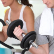 Young working out in a gym — Stock Photo