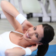 Young woman on an exercise mat — Stock Photo