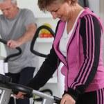 Older woman using a treadmill — Stock Photo