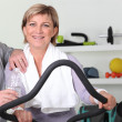 Stock Photo: Senior couple training in the gym
