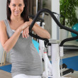 Woman in fitness room — Foto de Stock