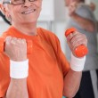 Happy senior woman working out in gym — Stock Photo