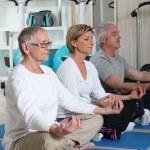 Mature adults doing meditation — Stock Photo