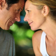 Head and shoulders of mature romantic couple looking at each other — Stock Photo