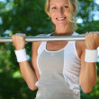 Womdoing chin-ups — Stock Photo #7897167