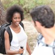 Interracial couple hiking in the forest — Stock Photo #7897436