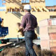 Stock Photo: Roofer working on unfinished house