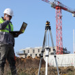 Stock Photo: Two surveyors working on site