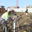 Stock Photo: Civil engineers on site with surveying equipment