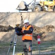 Surveyor working on a construction site — Stock Photo