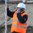 Stock Photo: Surveyor taking measurements