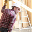 Woodworker on construction site — Stock Photo #7897910