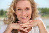 Blond resting head on hands — Stock Photo