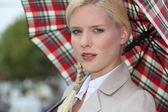 Snobby woman holding an umbrella — Stock Photo