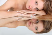 Mirror image of a woman — Stock Photo