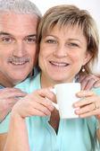Couple with mug of coffee — Stock Photo