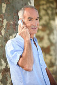 Senior man at phone — Stock Photo