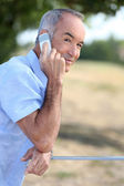 Middle-aged man, making telephone call outdoors — Stock Photo