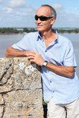 Senior tourist in Blaye, France — Stock Photo