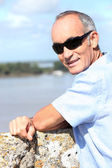 Pensioner on holiday — Stock Photo