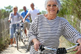 Older woman and friends on a bike ride — Stock Photo