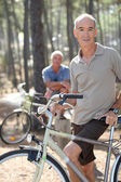 Two older men out for a bike ride — Stock Photo