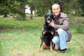 Man with his dog — Stock Photo