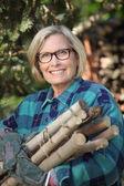 Woman gathering wood — Stock Photo