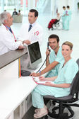 Hospital staff at the reception — Stock Photo