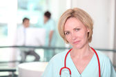Portrait of beautiful female surgeon — Stock Photo