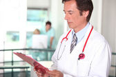 Male doctor with clipboard — Stock Photo