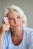 Woman fed up with taking her medication — Stock Photo