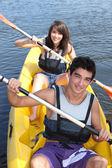 Teenagers canoeing — Stock Photo