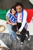 Football fans cheering on the Italian team — Stock Photo
