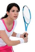 Woman playing tennis — Stok fotoğraf