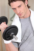 Determined man with a dumbbell — Stock Photo