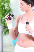 Woman working out in gym — Stock Photo