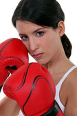 Tough woman with her boxing gloves — Stock Photo