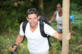 Happy couple on a mountain hike — Stock Photo