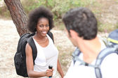 Interracial couple hiking in the forest — Stock Photo