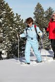 Mature couple snowshoeing — Stock Photo