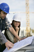 Construction site workers — Stock Photo