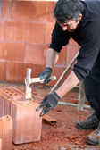 Builder hammering a brick — Stock Photo