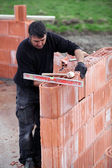 Bricklayer building a house — Stock Photo