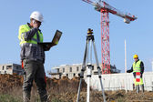Two surveyors working on site — Stock Photo