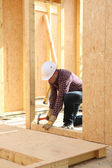 Man hammering nail — Stock Photo