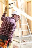Woodworker on a construction site — Stock Photo